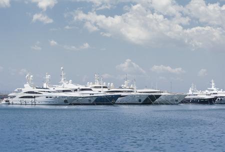 yacht: Luxury yachts in marina, docked on the pier Stock Photo