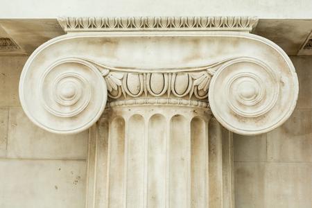 corinthian column: Decorative detail of an ancient Ionic column. close up. Stock Photo