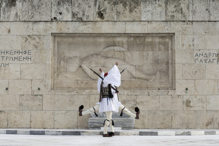 tsolias: Soldiers of the presidential guard marching in front of the monument of the Unknown Soldier in Athens, Greece.