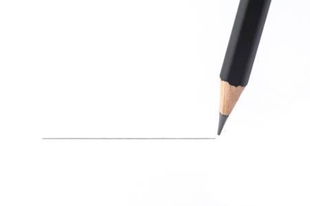 Black pencil drawing a straight line, isolated on white background Standard-Bild