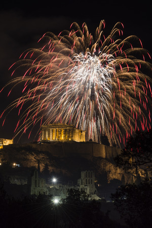 Fireworks explode over the temple of acropolis in Athens, Greece