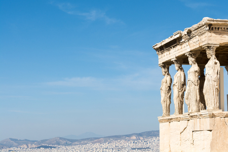 Female statues called caryatids in the Erechtheion at the sacred rock of the acropolis of Athens