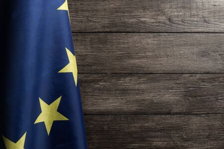 The European flag hanged against wooden wall background