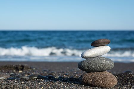 Balanced stones on the beach
