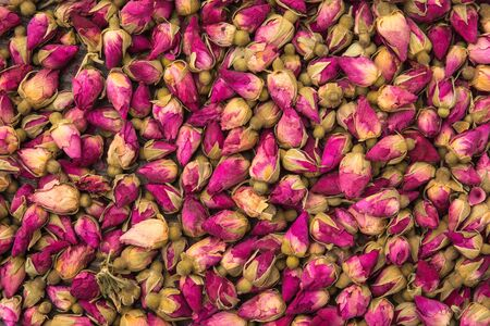 Dried rose buds background pattern close up