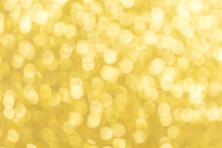 Abstract defocused gold lights bokeh background pattern