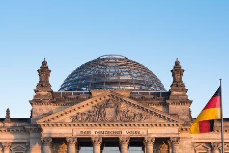 German flag waving front of Reichstag building. Berlin, Germany
