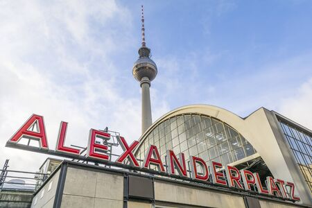 Alexanderplatz train station signage and the television tower in central Berlin at Mitte district, Germany Stock Photo