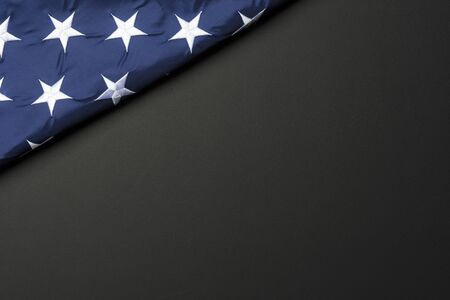 American flag lying on black grainy background Standard-Bild - 143109701