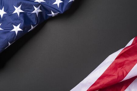 American flag lying on black grainy background Standard-Bild - 145522424
