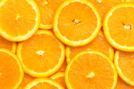 Full frame of fresh orange fruit slices pattern background, close up, high angle view Standard-Bild