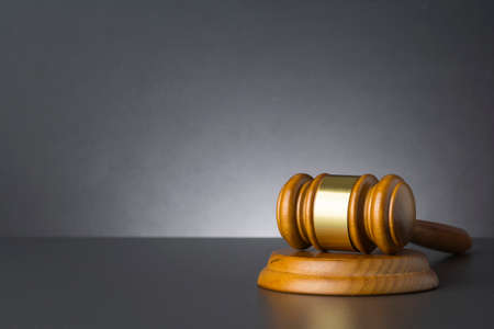 Wooden judge gavel against grey background , close up