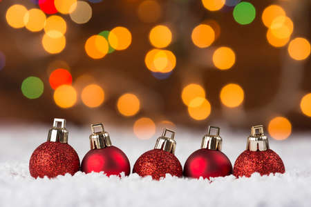 Christmas baubles on Snow with colorful bokeh lights Standard-Bild
