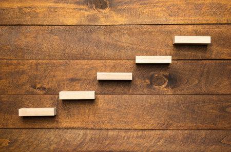 Wooden blocks form a ladder as a development concept