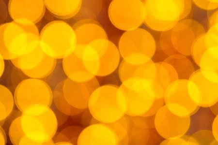 Full frame shot of golden defocused lights on red backgroound Standard-Bild