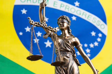 The statue of justice Themis or Justitia, the blindfolded goddess of justice against the flag of Brazil, as a legal concept Standard-Bild