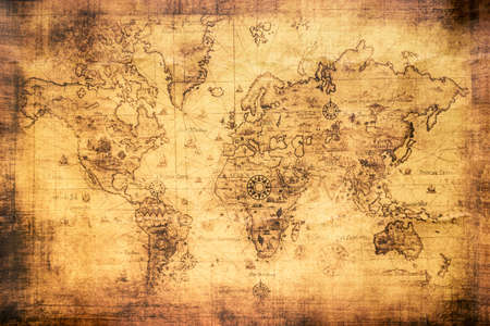 Vintage world map on an old stained parchment