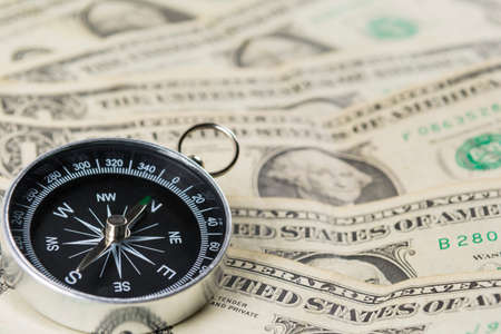 Compass with US dollar notes Standard-Bild