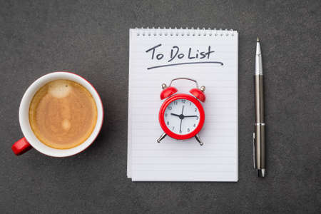 The to do list with cup of coffee and a clock as a time management concept