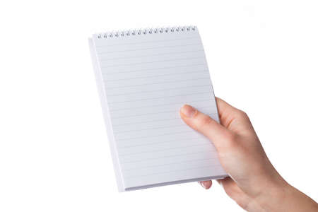 Cropped female hand holds a blank notepad with copy space, isolated on white background
