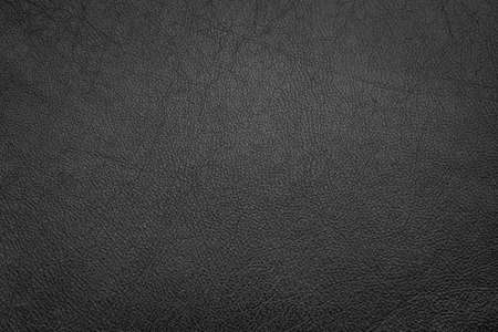 Black leather background texture, close up