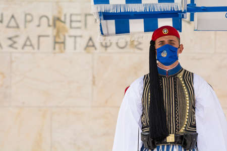 ATHENS, GREECE - APR 25, 2021: Soldier of the presidential guard standing in front of the monument of the Unknown Soldier in Athens, Greece. Editorial
