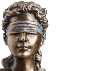 Portrait of the blindfolded goddess of justice Themis isolated on white background with copy space, as a legal concept