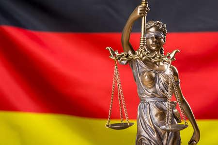 Lady justice against German flag