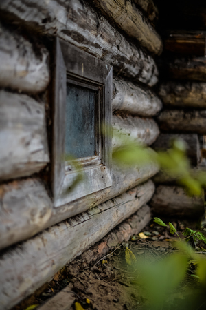 forgotten: Filthy old tiny window in the forgotten house in a village in Russia