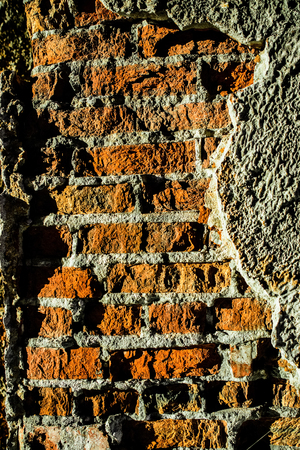 peeled off: Plaster peeled off from the old walls and became visible brickwork