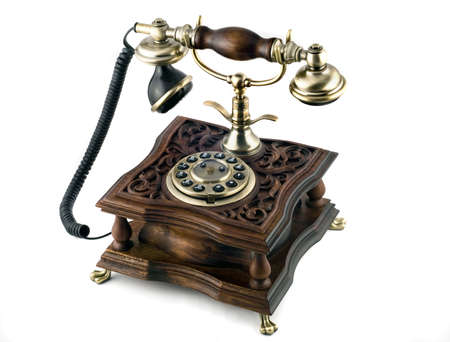 Antique telephone with modern buttons isolated