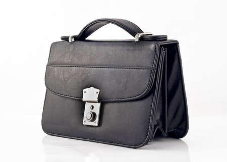 pochette: Black pochette or small bag isolated over white