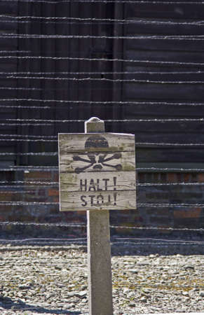 Caution sign board in Auschwitz concentration camp, Poland photo