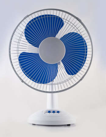 Modern desk cooling fan over white and grey background photo