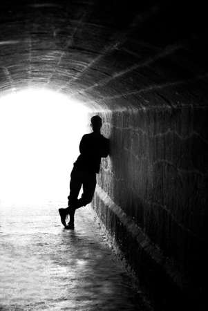 elysium: Human silhouette in back lighting in tunnel exit (shallow DOF)