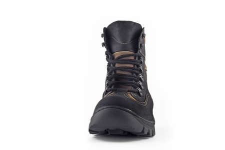 Front view of Warm leather boot for wearing in winter or traveling (isolated, over white) photo
