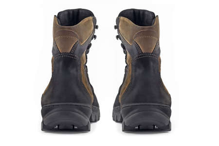 furskin: Rear (back) view of pair of Warm leather boots for wearing in winter or traveling (isolated, over white)