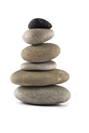 Balanced stone stack or tower isolated over white