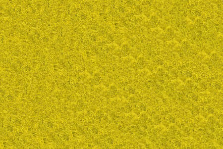 filamentous: Close-up of yellow synthetic fibrous surface useful as background