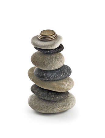 sufficiency: Stability and welfare - Tall Balanced stone stack or tower with coins on top over white