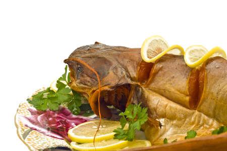 sheatfish: Orilla cena - pez de agua dulce (sheatfish) con lim�n y perejil  Foto de archivo
