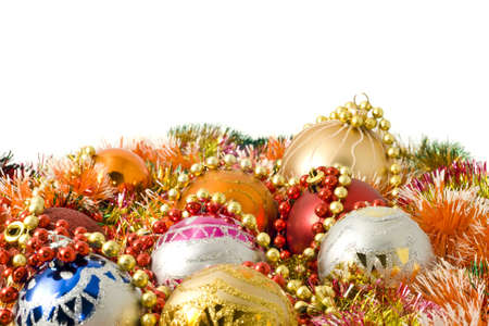 Christmas and New Year decoration - colorful tinsel and balls over white background photo