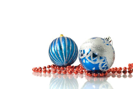 Christmas decoration -  two blue balls and red beads over white photo