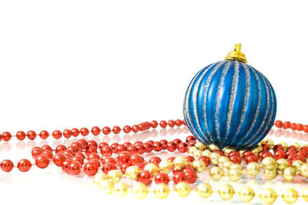 Christmas decoration - colorful beads and striped blue ball over white photo