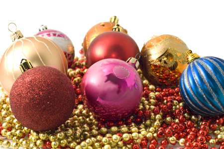 Christmas decoration - group of balls and colorful beads and over white photo