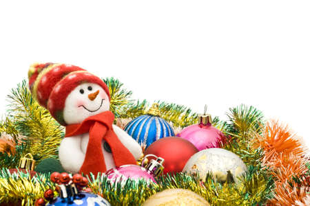 Christmas greeting - Cute snowman and group of balls over white Stock Photo