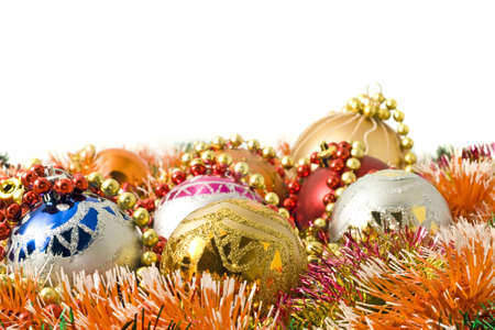 Christmas greeting - group of balls and colorful beads and over white photo