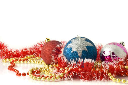 Christmas greeting card - red, blue and pink balls over white photo