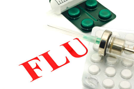 h1n1 vaccinations: Swine FLU H1N1 warning - pills and syringe over white
