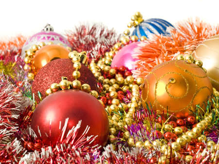 Christmas colorful decoration - baubles, tinsel and beads over white photo